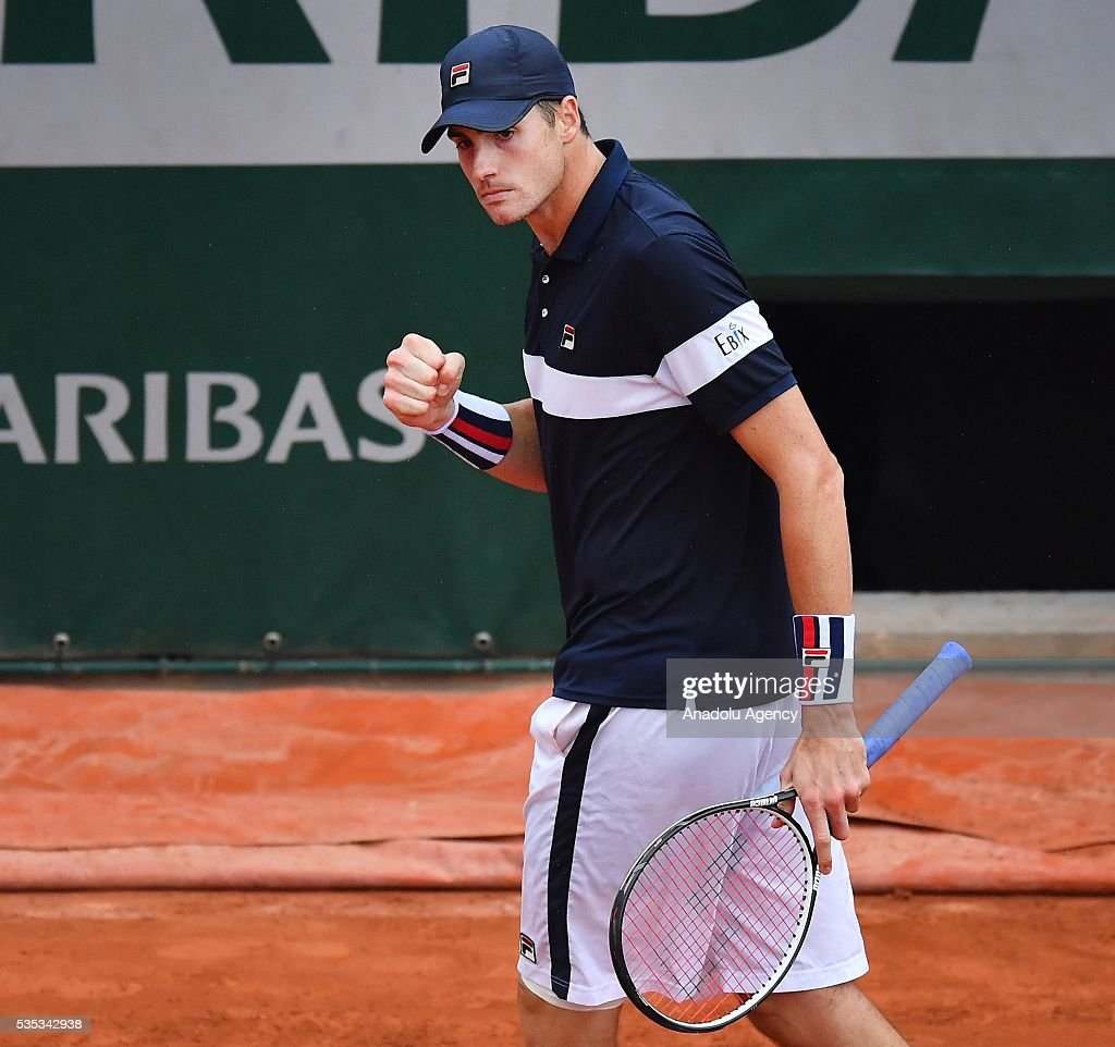 John Isner of US reacts during the match against Andy Murray of United Kingdom in the men's single fourth round match at the French Open tennis tournament at Roland Garros in Paris, France on May 29, 2016.