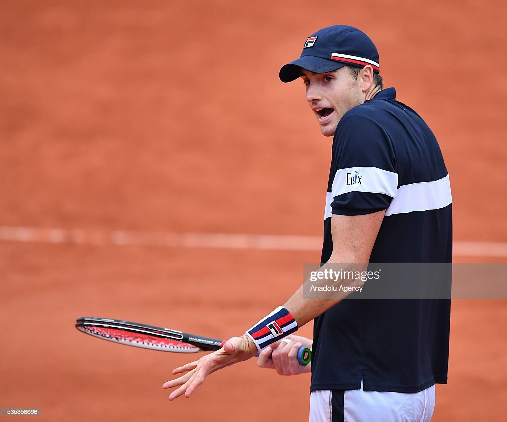 John Isner of US reacts during the match against Andy Murray of United Kingdom in the men's single fourth round match at the French Open tennis tournament at Roland Garros Stadium in Paris, France on May 29, 2016.
