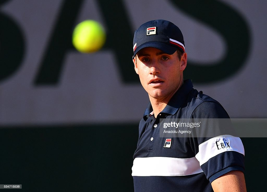 John Isner of US returns to Teymuraz Gabashvili (not seen) of Russia during the men's single third round match at the French Open tennis tournament at Roland Garros Stadium in Paris, France on May 27, 2016.