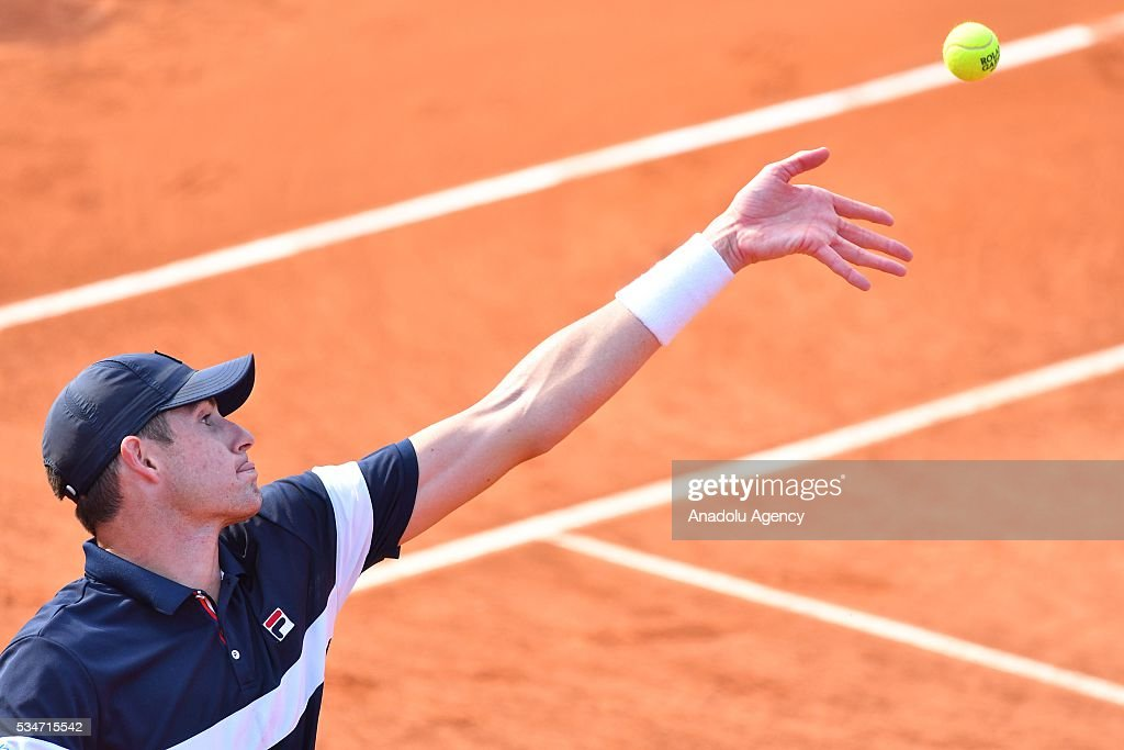 John Isner of US serves to Teymuraz Gabashvili (not seen) of Russia during the men's single third round match at the French Open tennis tournament at Roland Garros Stadium in Paris, France on May 27, 2016.