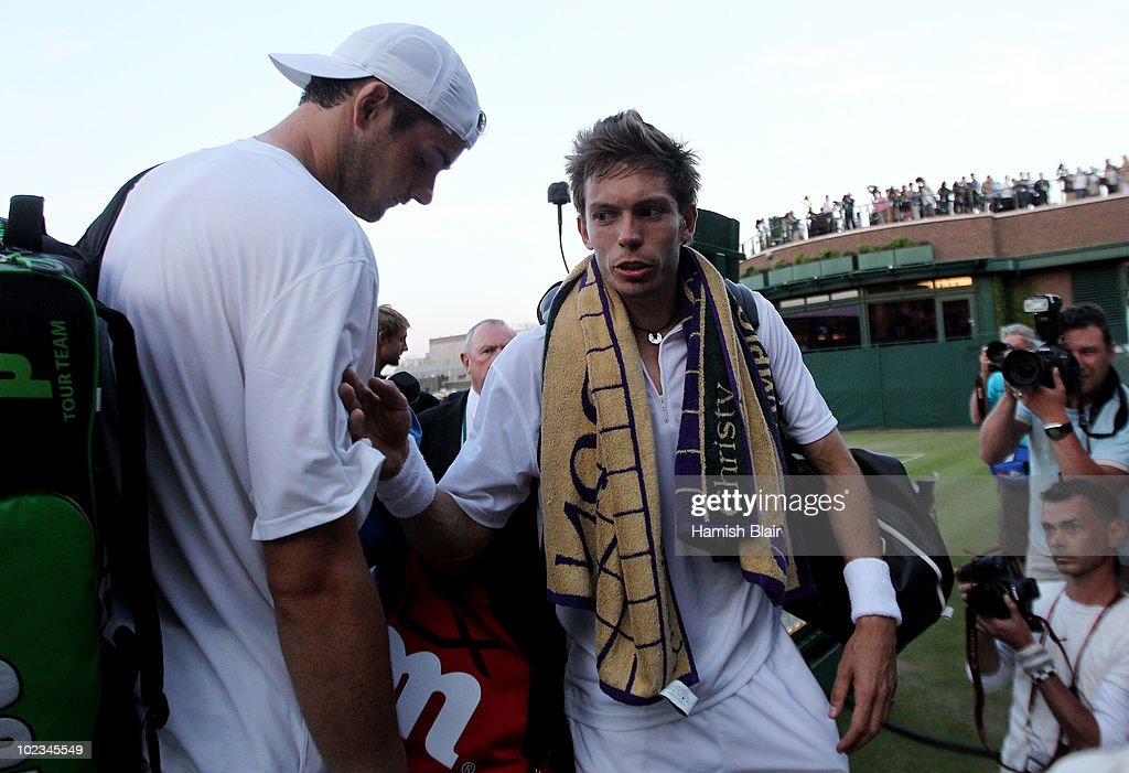 John Isner of USA (L) and Nicolas Mahut of France prepare to leave court 18 as light stops play at 59-59 in the last set on Day Three of the Wimbledon Lawn Tennis Championships at the All England Lawn Tennis and Croquet Club on June 23, 2010 in London, England. The game has become the longest in Grand Slam history