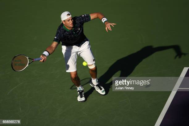 John Isner of USA in action against Alexander Zverev of Germany in his match against at Crandon Park Tennis Center on March 27 2017 in Key Biscayne...