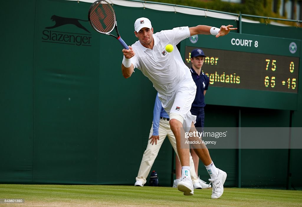 John Isner of USA in action against Marcos Baghdatis of Cyprus in the men's singles on day four of the 2016 Wimbledon Championships at the All England Lawn and Croquet Club in London, United Kingdom on June 30, 2016.