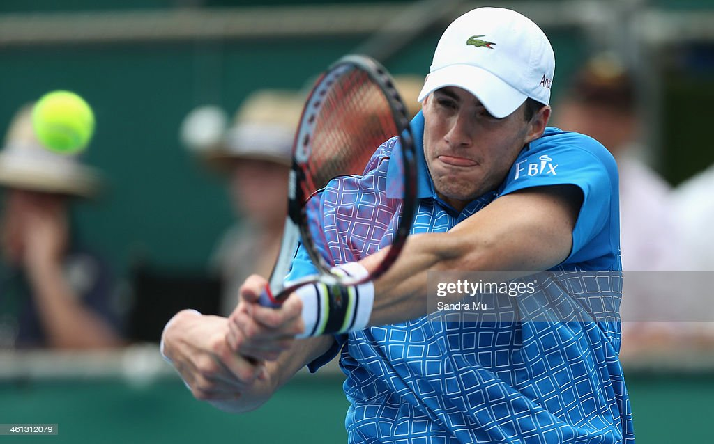 John Isner of USA plays a backhand during his match against Lukas Lacko of Slovakia on day three of the Heineken Open at ASB Tennis Centre on January 8, 2014 in Auckland, New Zealand.