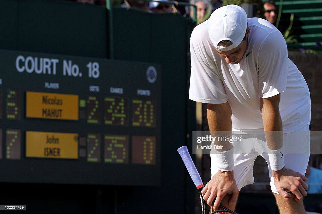 <a gi-track='captionPersonalityLinkClicked' href=/galleries/search?phrase=John+Isner+-+Tennis+Player&family=editorial&specificpeople=4439464 ng-click='$event.stopPropagation()'>John Isner</a> of USA reacts during his first round match against Nicolas Mahut of France on Day Three of the Wimbledon Lawn Tennis Championships at the All England Lawn Tennis and Croquet Club on June 23, 2010 in London, England. The match has become the longest in Grand Slam history.