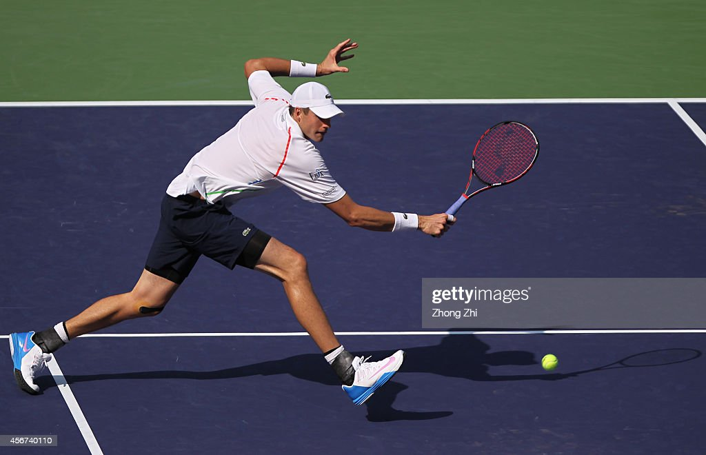 John Isner of USA returns a shot during his match against Pablo Andujar of Spain during the day 2 of the Shanghai Rolex Masters at the Qi Zhong Tennis Center on October 6, 2014 in Shanghai, China.
