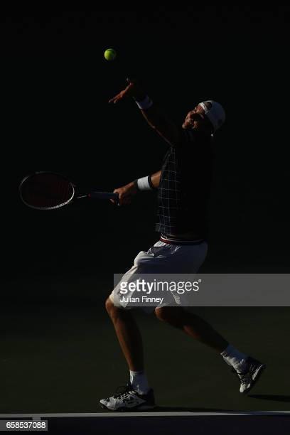 John Isner of USA serves to Alexander Zverev of Germany in his match against at Crandon Park Tennis Center on March 27 2017 in Key Biscayne Florida