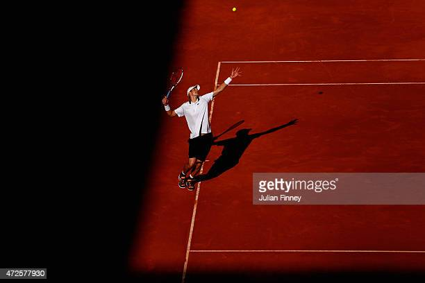 John Isner of USA serves to Tomas Berdych of Czech Republic in the quarter finals during day seven of the Mutua Madrid Open tennis tournament at the...