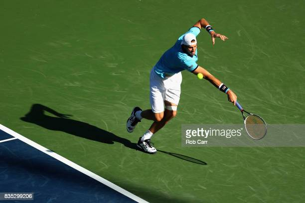 John Isner plays a shot against Jared Donaldson during Day 7 of the Western and Southern Open at the Linder Family Tennis Center on August 18 2017 in...