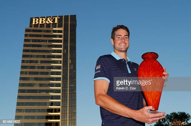 John Isner poses with the trophy after winning the BBT Atlanta Open at Atlantic Station on July 30 2017 in Atlanta Georgia