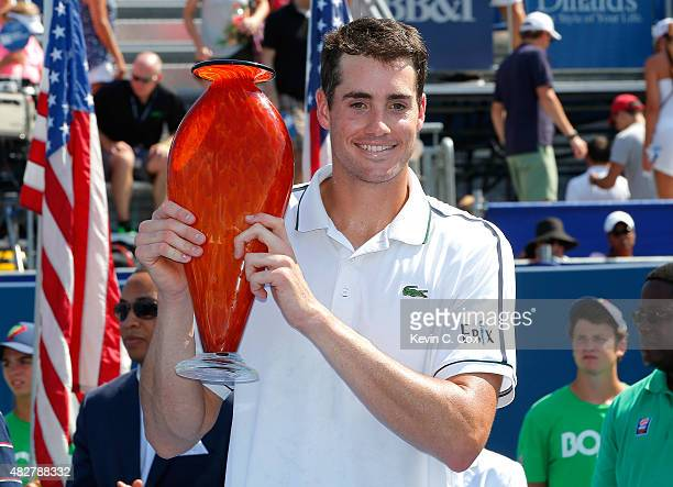 John Isner poses with trophy after defeating Marcos Baghdatis of Cyprus during the BBT Atlanta Open Final at Atlantic Station on August 2 2015 in...