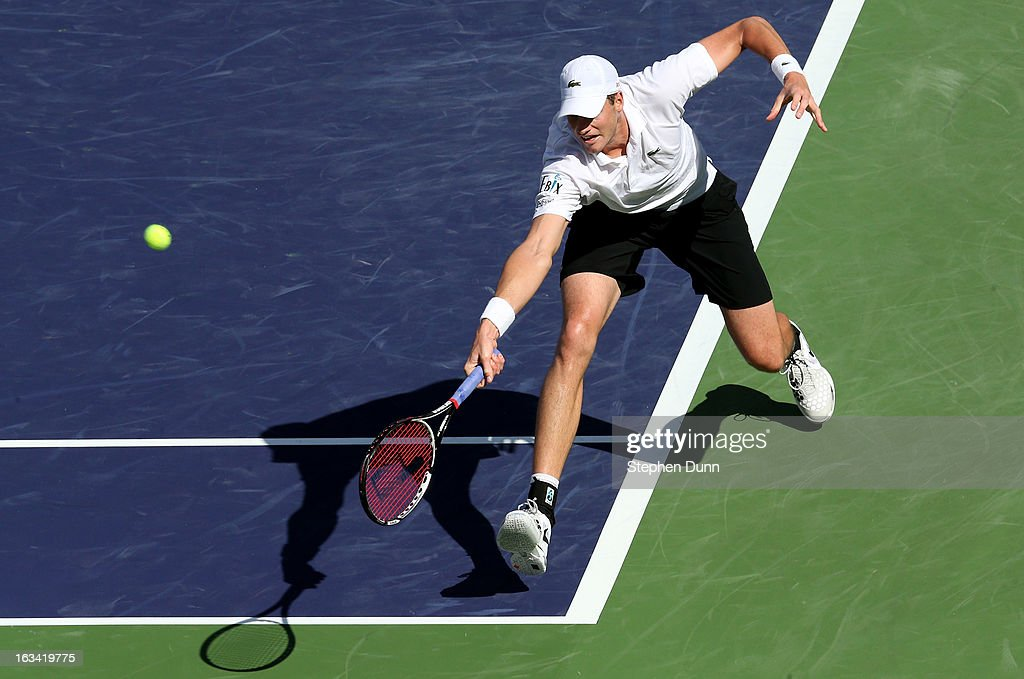 John Isner reaches for a shot from Lleyton Hewitt of Australia during day 4 of the BNP Paribas Open at Indian Wells Tennis Garden on March 9, 2013 in Indian Wells, California. Sto0sur won 6-3, 6-4.