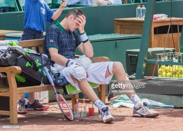 John Isner reacts after losing a set during the US Men's Clay Court Championships on April 14 2017 at River Oaks Country Club in Houston Texas