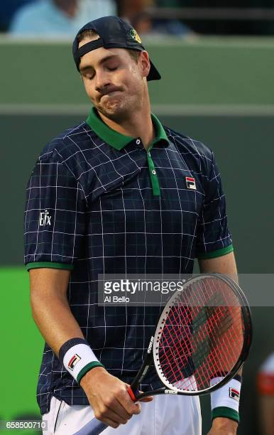 John Isner reacts to alost point against Alexander Zverev of Germany during Day 8 of the Miami Open at Crandon Park Tennis Center on March 27 2017 in...
