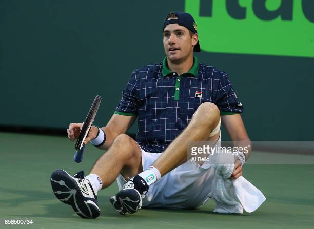 John Isner reacts to losing a challenge against Alexander Zverev of Germany during Day 8 of the Miami Open at Crandon Park Tennis Center on March 27...