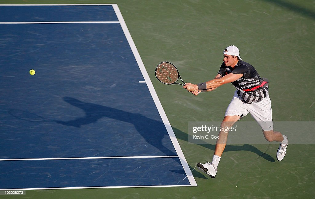 John Isner returns a backhand to Gilles Muller of Luxembourg on Day 3 of the Atlanta Tennis Championships at the Atlanta Athletic Club on July 21, 2010 in Atlanta, Georgia.