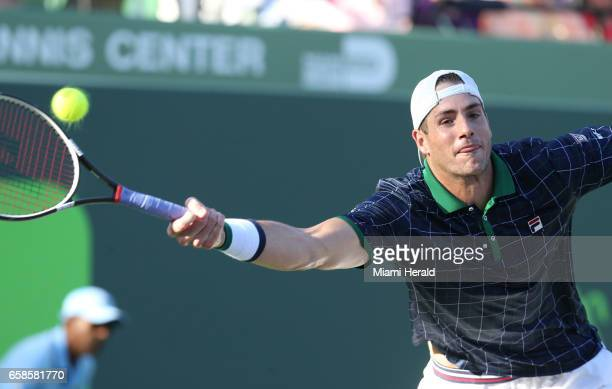 John Isner returns a ball hit by Alexander Zverev at the Miami Open on Monday March 27 2017 on Key Biscayne Fla