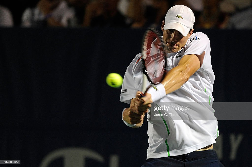 <a gi-track='captionPersonalityLinkClicked' href=/galleries/search?phrase=John+Isner&family=editorial&specificpeople=4439464 ng-click='$event.stopPropagation()'>John Isner</a> returns a shot from Mikhail Kukushkin of Kazakhstan during the Winston-Salem Open at Wake Forest University on August 20, 2014 in Winston Salem, North Carolina.