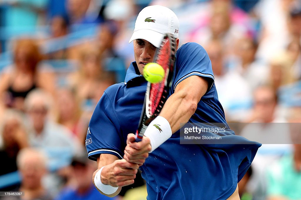 <a gi-track='captionPersonalityLinkClicked' href=/galleries/search?phrase=John+Isner+-+Tennis+Player&family=editorial&specificpeople=4439464 ng-click='$event.stopPropagation()'>John Isner</a> returns a shot to Dmitry Tursunov of Russia during the semifinals of the Citi Open at the William H.G. FitzGerald Tennis Center on August 3, 2013 in Washington, DC.
