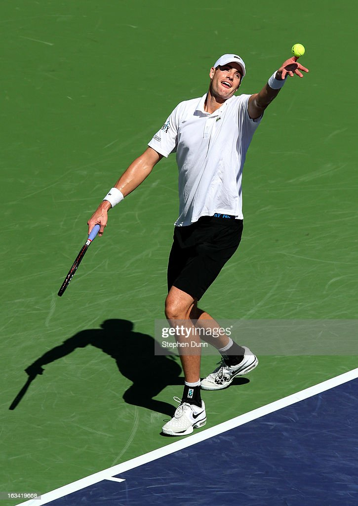 John Isner serves to Lleyton Hewitt of Australia during day 4 of the BNP Paribas Open at Indian Wells Tennis Garden on March 9, 2013 in Indian Wells, California. Sto0sur won 6-3, 6-4.