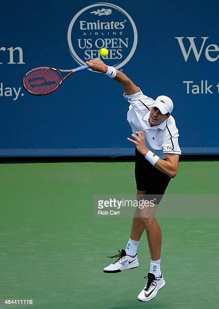 John Isner serves to Sam Querrey during Day 4 of the Western Southern Open at the Linder Family Tennis Center on August 18 2015 in Cincinnati Ohio