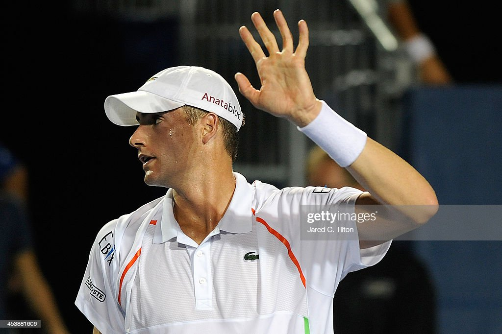 John Isner waves to the crowd after defeating Mikhail Kukushkin of Kazakhstan during the Winston-Salem Open at Wake Forest University on August 20, 2014 in Winston Salem, North Carolina.