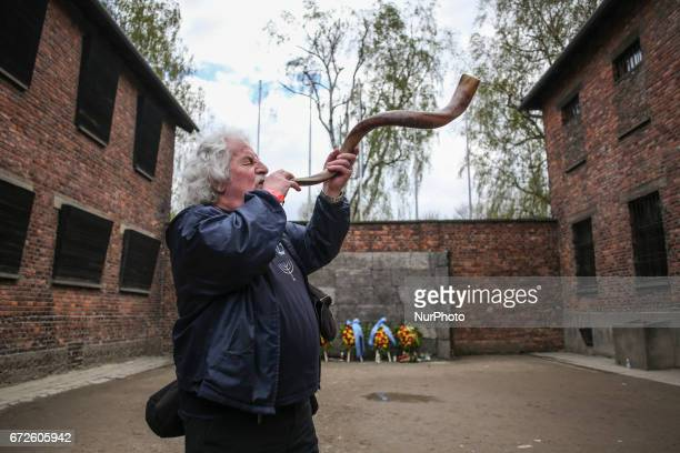 John J Podmolik plays shofar during the 'March of the Living' at the former NaziGerman Auschwitz concentration and extermination camp at Oswiecim...