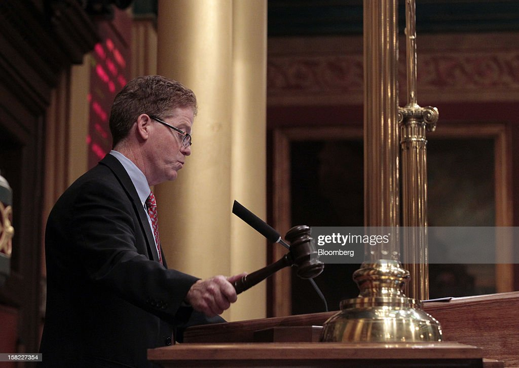 John J. Walsh, speaker pro tempore of the Michigan House of Representatives, slams the gavel after the final vote for H.B. 4003, one of the right-to-work bills, at the Capitol in Lansing, Michigan, U.S., on Tuesday, Dec. 11, 2012. Michigan lawmakers approved bills to prohibit mandatory union dues in workplaces as thousands of chanting protesters thronged the Capitol. Photographer: Jeff Kowalsky/Bloomberg via Getty Images