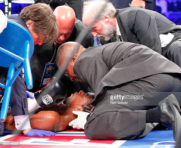 John Jackson of the Virgin Islands is attended to after being knocked out by Andy Lee of Ireland in the fifth round of their NABF Super Welterweight...