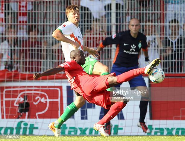 John Jairo Mosquera of Berlin kicks for the ball in front of Sebastian Proedl of Bremen during the Season Friendly match between Union Berlin and...