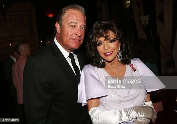 John James and Joan Collins pose at the Friars Club salute to Joan Collins at The Friars Club on May 4 2015 in New York City