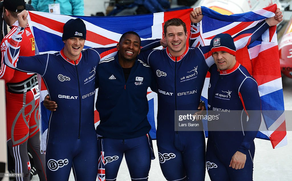 John James Jackson, Stuart Benson, Bruce Tasker and Joel Fearon of Great Britain react after the Four Men Bobsleigh final heat of the IBSF Bob & Skeleton World Championship at Olympia Bob Run on February 3, 2013 in St Moritz, Switzerland.