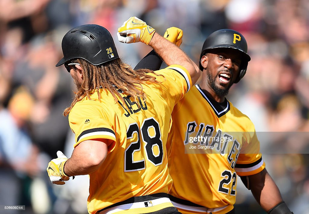John Jaso #28 celebrate his solo home run with Andrew McCutchen #22 of the Pittsburgh Pirates during the ninth inning against the Cincinnati Reds on May 1, 2016 at PNC Park in Pittsburgh, Pennsylvania. Cincinnati won the game 6-5.