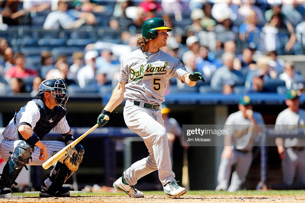 <a gi-track='captionPersonalityLinkClicked' href=/galleries/search?phrase=John+Jaso&family=editorial&specificpeople=4951282 ng-click='$event.stopPropagation()'>John Jaso</a> #5 of the Oakland Athletics follows through on a fifth inning base hit against the New York Yankees at Yankee Stadium on May 4, 2013 in the Bronx borough of New York City.