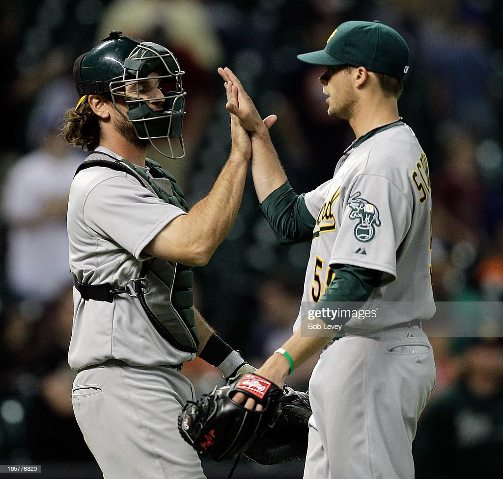 <a gi-track='captionPersonalityLinkClicked' href=/galleries/search?phrase=John+Jaso&family=editorial&specificpeople=4951282 ng-click='$event.stopPropagation()'>John Jaso</a> #5 of the Oakland Athletics high fives Evan Scribner #58 of the Oakland Athletics after the final out against the Houston Astros at Minute Maid Park on April 5, 2013 in Houston, Texas.