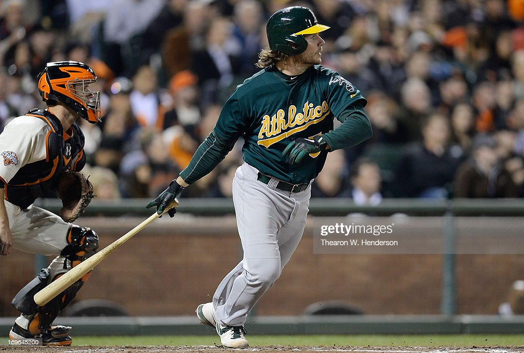 <a gi-track='captionPersonalityLinkClicked' href=/galleries/search?phrase=John+Jaso&family=editorial&specificpeople=4951282 ng-click='$event.stopPropagation()'>John Jaso</a> #5 of the Oakland Athletics hits an RBI single with the bases loaded driving in Jed Lowrie #8 against the San Francisco Giants in the fifth inning at AT&T Park on May 29, 2013 in San Francisco, California.