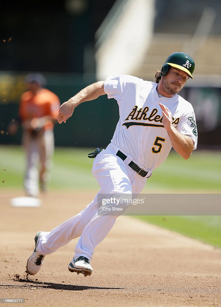 John Jaso #5 of the Oakland Athletics rounds third base on his way home to score on a hit by Chris Young #25 in the first inning against the Houston Astros at O.co Coliseum on April 17, 2013 in Oakland, California.