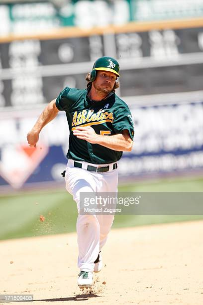 John Jaso of the Oakland Athletics runs the bases during the game against the Seattle Mariners at Oco Coliseum on June 16 2013 in Oakland California...