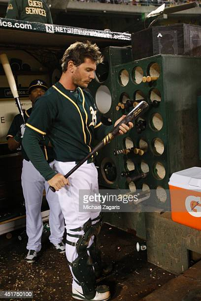 John Jaso of the Oakland Athletics stands in the dugout during the game against the Boston Red Sox at Oco Coliseum on June 20 2014 in Oakland...