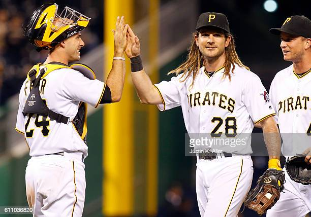 John Jaso of the Pittsburgh Pirates celebrates with Eric Fryer after defeating the Chicago Cubs 84 at PNC Park on September 28 2016 in Pittsburgh...