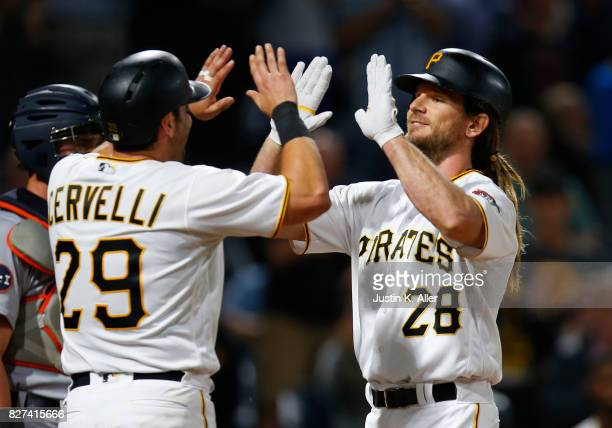 John Jaso of the Pittsburgh Pirates celebrates with Francisco Cervelli after hitting a pinch hit two run home run in the seventh inning against the...