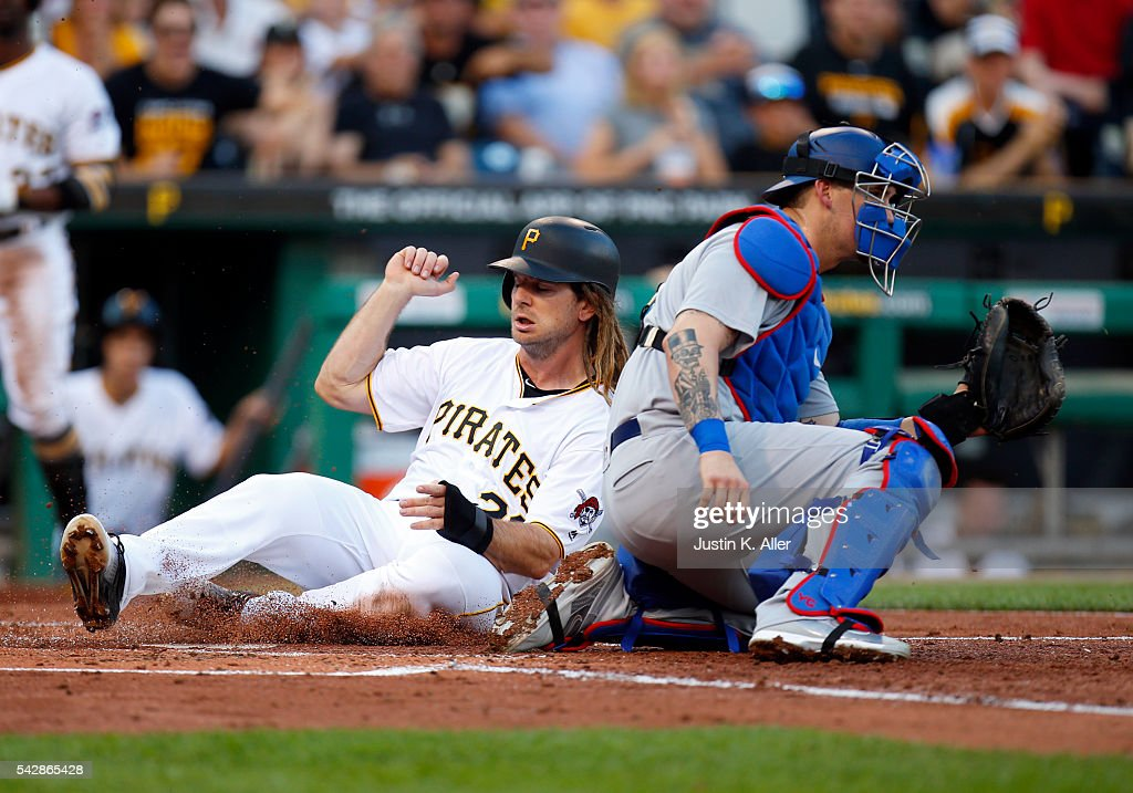 <a gi-track='captionPersonalityLinkClicked' href=/galleries/search?phrase=John+Jaso&family=editorial&specificpeople=4951282 ng-click='$event.stopPropagation()'>John Jaso</a> #28 of the Pittsburgh Pirates scores on a RBI double by <a gi-track='captionPersonalityLinkClicked' href=/galleries/search?phrase=Yasmani+Grandal&family=editorial&specificpeople=7510522 ng-click='$event.stopPropagation()'>Yasmani Grandal</a> #9 in the second inning during the game against the Los Angeles Dodgers at PNC Park on June 24, 2016 in Pittsburgh, Pennsylvania.