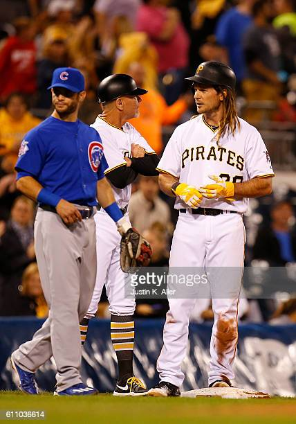 John Jaso of the Pittsburgh Pirates stands on third base after hitting for the cycle in the seventh inning during the game against the Chicago Cubs...