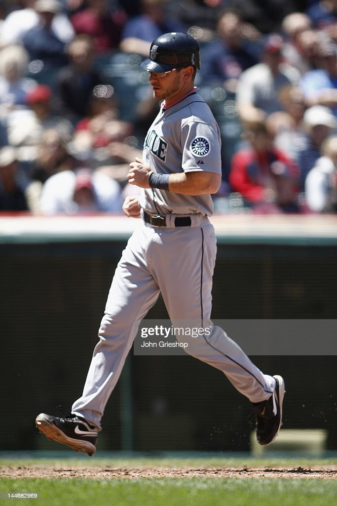 <a gi-track='captionPersonalityLinkClicked' href=/galleries/search?phrase=John+Jaso&family=editorial&specificpeople=4951282 ng-click='$event.stopPropagation()'>John Jaso</a> #27 of the Seattle Mariners crosses home plate scoring a run during the game against the Cleveland Indians at Progressive Field on May 17, 2012 in Cleveland, Ohio.