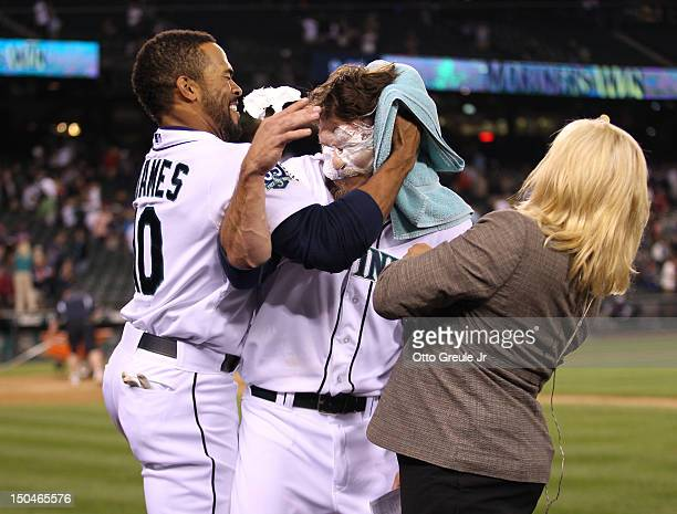 John Jaso of the Seattle Mariners is smeared with a shaving cream pie by Eric Thames after getting the game winning hit in the ninth inning to defeat...