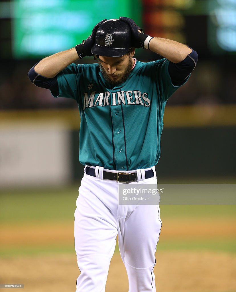 <a gi-track='captionPersonalityLinkClicked' href=/galleries/search?phrase=John+Jaso&family=editorial&specificpeople=4951282 ng-click='$event.stopPropagation()'>John Jaso</a> #27 of the Seattle Mariners reacts after being called out on strikes in the ninth inning against the Tampa Bay Rays at Safeco Field on August 13, 2012 in Seattle, Washington. The Rays defeated the Mariners 4-1.