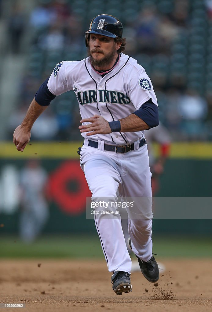 John Jaso #27 of the Seattle Mariners rounds the bases against the Los Angeles Angels of Anaheim at Safeco Field on October 3, 2012 in Seattle, Washington.