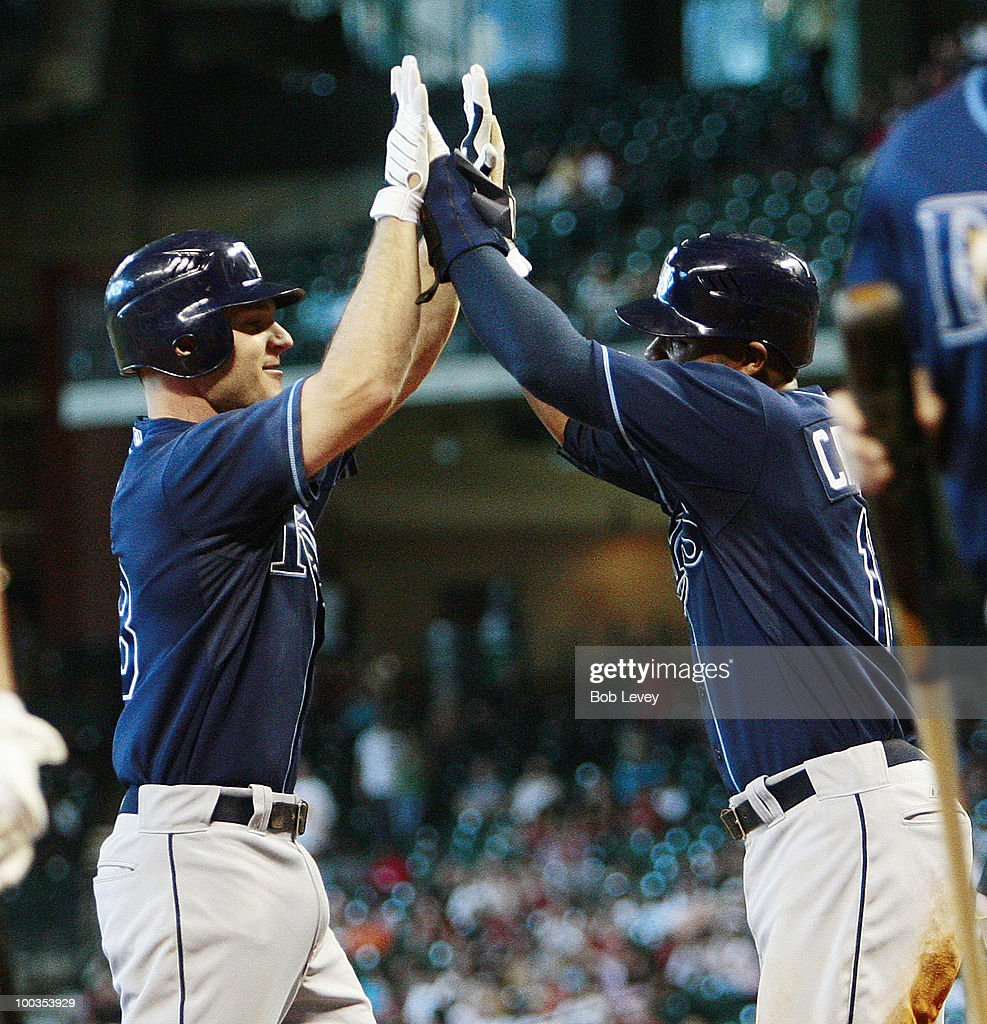 John Jaso #28 of the Tampa Bay Rays gets high fives from Carl Crawford after hitting a two run home run in the fifth against the Houston Astros at Minute Maid Park on May 23, 2010 in Houston, Texas.