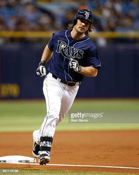 John Jaso of the Tampa Bay Rays rounds third base after hitting a home run off of pitcher Marco Estrada of the Toronto Blue Jays during the first...