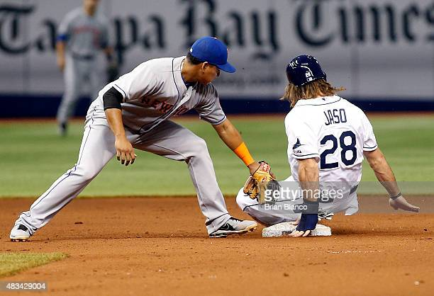 John Jaso of the Tampa Bay Rays steals second base ahead of shortstop Ruben Tejada of the New York Mets during the fourth inning of a game on August...